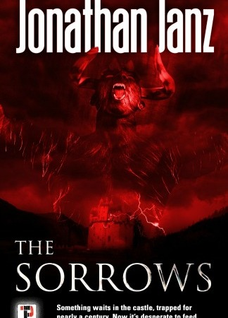 "All is red and black. A castle sits in front of a red sky as a demonic figure appears in the sky above. Text: ""Jonathan Janz. The Sorrows. Something waits in the castle, trapped for nearly a century. Now it's desperate to feed."""