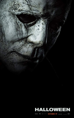 Image: Movie poster for Halloween. Michael Myers's white mask is in half profile against a black background.