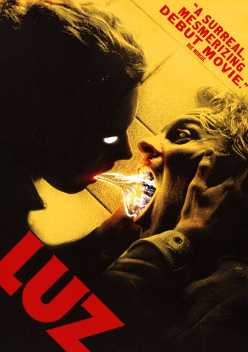 Image: Movie poster for Luz. A canted angle of two people facing each other with their mouths open against a yellow background. The person in the foreground has white eyes and pushes a white substance into the other person's mouth.