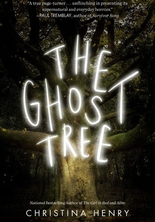 "Image: An old grey tree with no leaves sits in a dark forest. Eerie white letters read ""The Ghost Tree."""