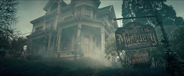 "Image: A large house sits on a lot with overgrown trees and fog rolling in. A sign hangs in front that reads: ""Raven's End Mortuary. Help Wanted."""