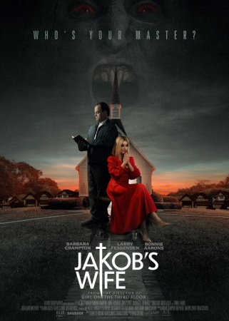 """Larry Fessenden stands in a dark suit while reading the Bible. Barbara Crampton sits next to him in a red dress. Behind them is a church with the ghostly image of a vampire looming behind it. Text reads, """"Who's your master? Jakob's Wife."""""""