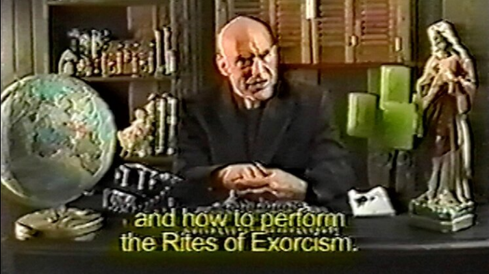 """A still from What Happens Next Will Scare You. A grainy shot of a priest sitting behind a desk covered in religious tchotchkes has a caption that reads, """"and how to perform the Rites of Exorcism."""""""